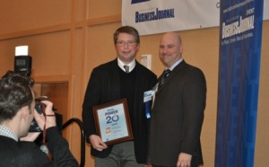 L-R: David Troy (founder of Roundhouse Technologies) receives his award from John Dinkel (Publisher, Baltimore Business Journal)