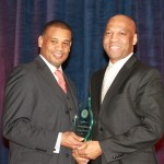L-R: LaRian Finney (president, Visionary Marketing Group, Inc) presents the Diversity Champion Award to W. Maurice Bridges (director of Supplier Diversity at BGE). Photo Credit: Olivier Rousset.