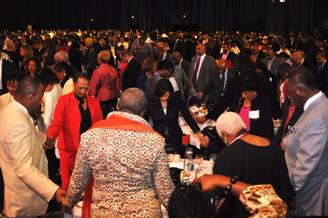 United and fired up with prayers. Attendees at the ALC Annual Prayer Breakfast join hands and pray for the nation. Report and Interviews by Ibrahim Dabo. Photo Credit: Ibrahim Dabo.