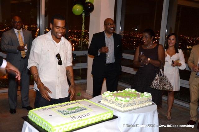 Mario Barrett prepares to cut birthday cake