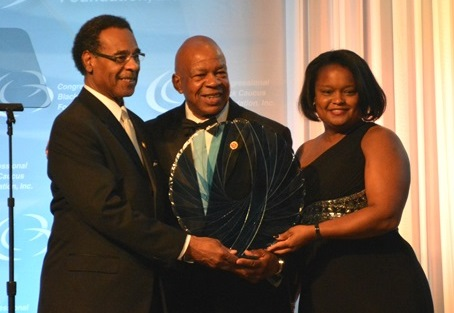 Representative Elijah E. Cummings accepts his award at the Phoenix dinner. Photo credit: Ibrahim Dabo.